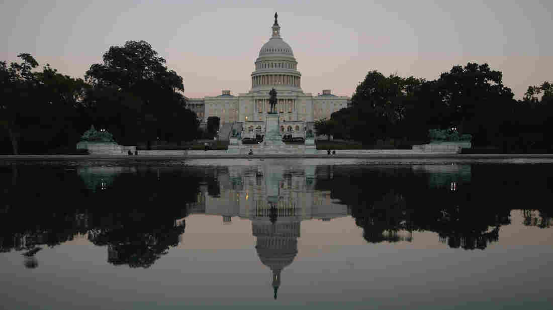 Dissatisfaction with America's government headed the list of problems cited in a new Gallup poll. Here, dusk falls on the U.S. Capitol on Sept. 30 — the eve of the federal shutdown that further frustrated many citizens.