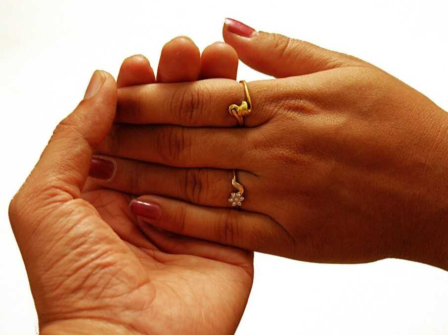 A pair of hands of different skin colors. Basically the default choice for a stock photo on a post about interracial romance.
