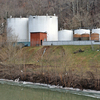The Freedom Industries facility sits on the banks of the Elk River last Friday, in Charleston, W.Va., site of a chemical spill that has led to a ban on using tap water in the area. The CDC says pregnant women in affected areas should drink only bottled water.