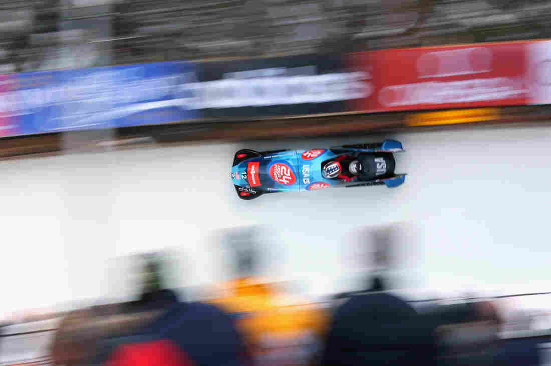 U.S. bobsledders Nick Cunningham and Abraham Morlu compete in a BMW-designed sled at the World Cup in January in St. Moritz, Switzerland. The U.S. team paired up with a BMW race car designer several years ago to boost its chances at the 2014 Winter Games.