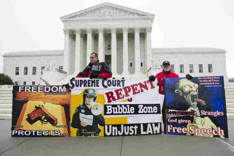 Pro-life demonstrators stand outside the U.S. Supreme Court following oral arguments in the case dealing with a Massachusetts law imposing a 35-foot buffer zone around abortion clinics for demonstrations and protests.