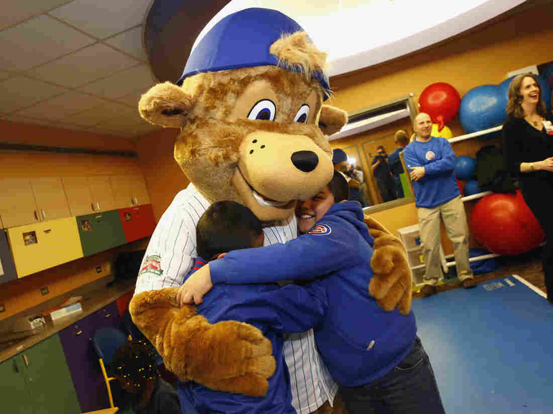 Clark, the Chicago Cubs' first mascot, hugs children during his debut at Advocate Illinois Masonic's Pediatric Developmental Center.