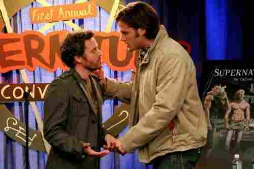 "Jared Padalecki plays Sam Winchester (right), one of the stars of the series Supernatural. The Winchester brothers also star in the series-within-the-series, which is --€"" meta alert! --€"" also called Supernatural. Here, Sam talks to the (fictional) series author at a (fictional) convention for (fictional) rabid fans."