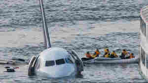 Jan. 15, 2009: As the U.S. Airways jet they had been on sinks into the Hudson River, passengers are rowed away. This isn't the iconic (and now copyrighted) photo that helped transform Twitter. But it does give a sense of what it was like that day, 5 years ago.