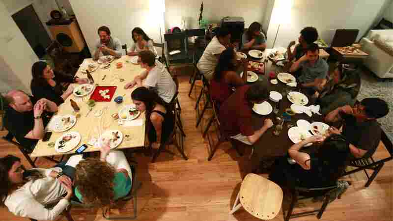 A group gathers in a Ballston, Va., home for a supper club organized through the site Feastly. A new food trend gaining popularity in New York and other cities lets diners enjoy a meal prepared by a stranger in that person's home.