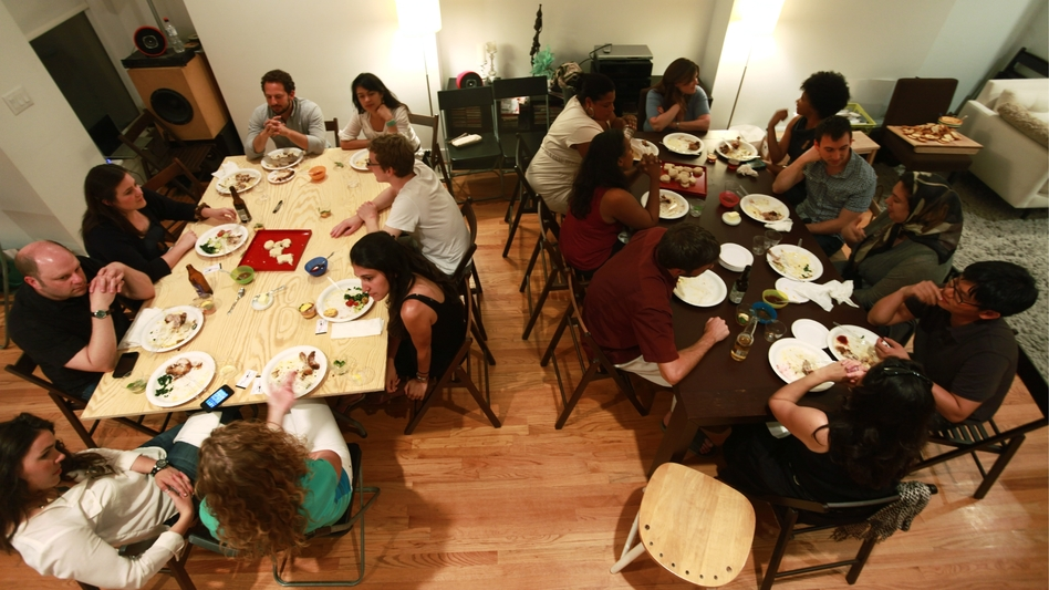 A group gathers in a Ballston, Va., home for a supper club organized through the site Feastly. A new food trend gaining popularity in New York and other cities lets diners enjoy a meal prepared by a stranger in that person's home. (Courtesy of Noah Karesh)