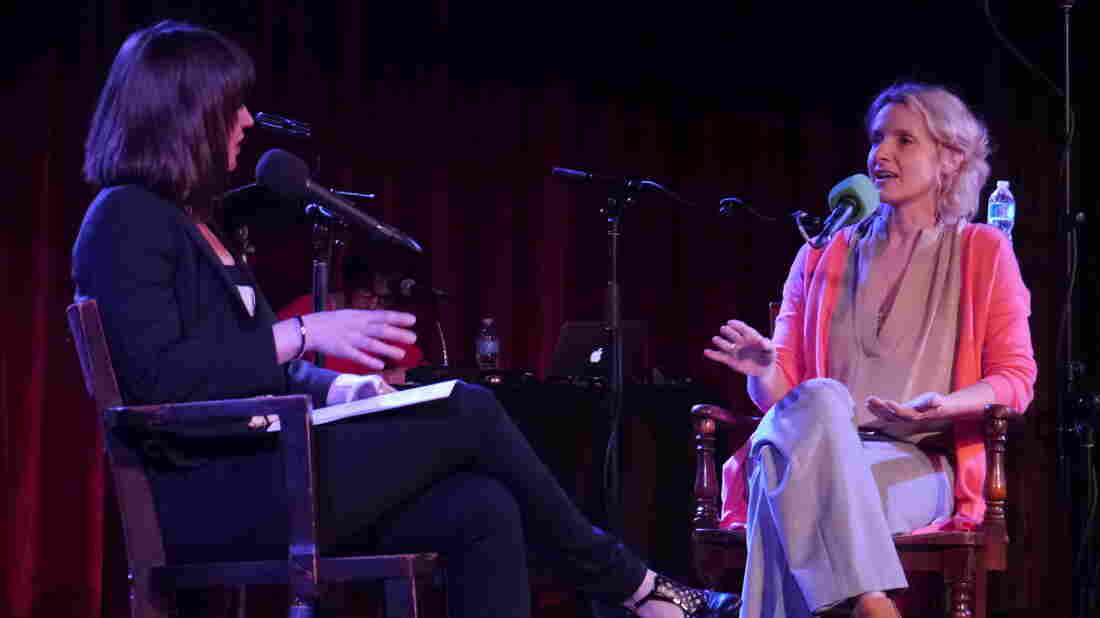 Very Important Puzzler Elizabeth Gilbert chats with Ask Me Another host Ophira Eisenberg on stage at The Bell House in Brooklyn, NY.