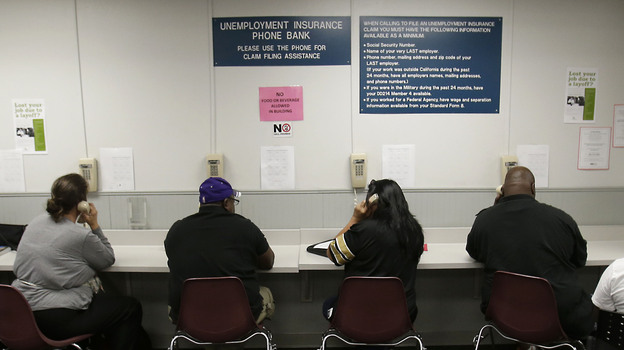 The lines were busy last September at an unemployment insurance phone bank operated by the California Employment Development Department in Sacramento. (AP)