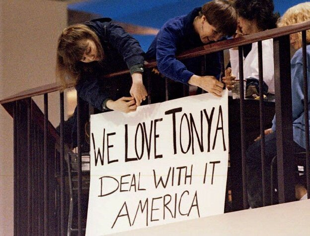 Fans of U.S. figure skater Tonya Harding put up a sign in support while she skated at the Clackamas Town Center ma