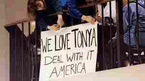 Fans of U.S. figure skater Tonya Harding put up a sign in support while she skated at the Clackamas Town Center mall rink in 1994, while a grand jury considered whether to indict her.