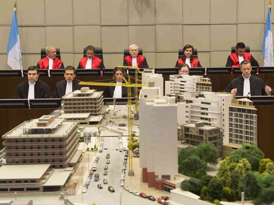 Back row from left, Judge Walid Akoum, Judge Janet Nosworthy, Presiding Judge David Re, Judge Micheline Braidy and Judge Nicola Lettier await the start of a trial at the courtroom of the Special Tribunal for Lebanon in Leidschendam, Netherlands, on Thursday.