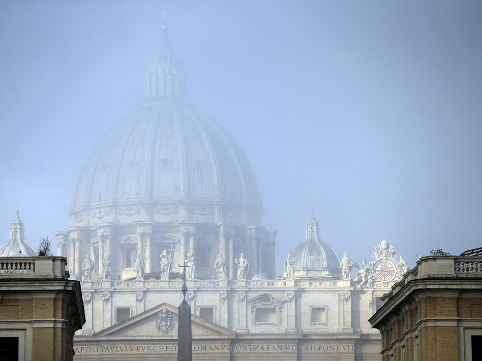 A light fog engulfs St. Peter's Basilica's dome at the Vatican on Saturday. The Vatican came in for tough public scrutiny over its handling of the clergy sex abuse scandal at a U.N. hearing in Geneva on Thursday. (Gregorio Borgia/AP)