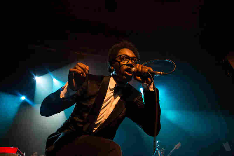 Congolese-Belgian artist Baloji started his globalFEST set at New York City's Webster Hall on Jan. 12, 2014 in high fashion - but by the end, he was working hard in rolled-up shirtsleeves.