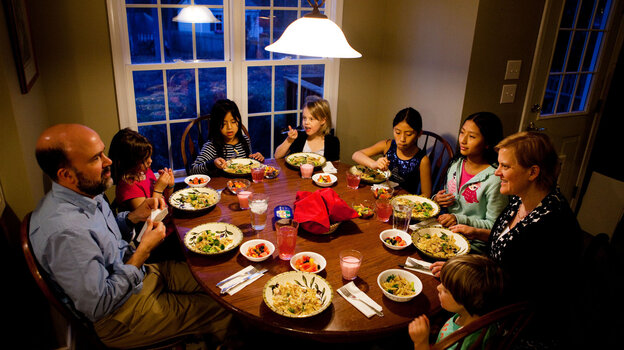 Americans are dining out less and eating at home more, new government research shows. This may mean more family dinners, like this one at the Brown-Spencer home in Mechanicsville, Va.