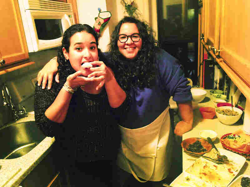 Glori Linares, left, and Victoria Delgado, invited strangers to a dinner party in their apartment in Brooklyn through the site EatWith.com.