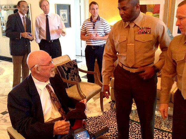"""Earlier this month, Hal Faulkner (left), 79, received his new papers from two Marines after having his military status changed to """"honorable discharge."""" Faulkner died Tuesday."""