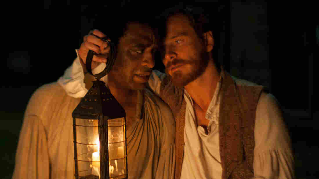 Chiwetel Ejiofor (left) plays Solomon Northup, a freeman kidnapped into slavery in 1841 and eventually resold to plantation owner Edwin Epps, played by Michael Fassbender.