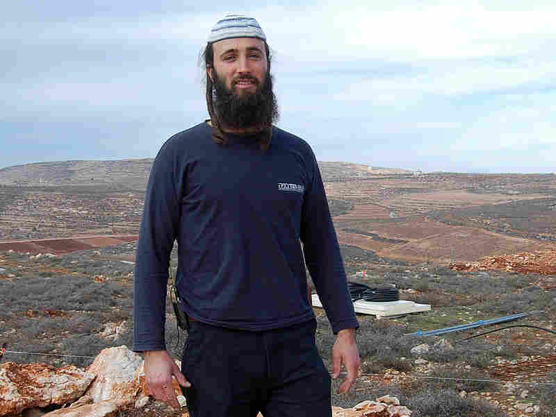 Pinahasi Baron is one of the Jewish settlers who were trapped by Palestinians last week in Qusra village and later arrested by Israeli police. He is shown here in Esh Kodesh, an Israeli outpost settlement across the valley from Qusra.