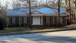 A close look at this house at 3215 Wade Ave. in Raleigh, N.C., suggests not all is as it seems. There isn't a driveway, for instance, and there's no walkway to the front door.