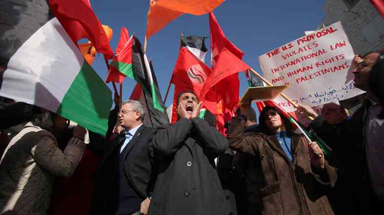 Palestinians protest in the center of the West Bank city of Ramallah against the continuation of negotiations with Israel, and demand that Palestinian president Mahmud Abbas not meet with U.S. Secretary of State John Kerry on Jan. 15, 2014.