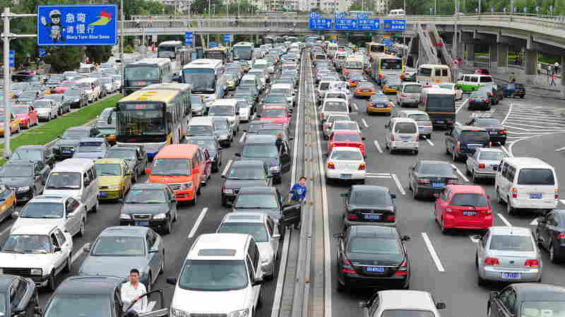 "Drivers step out of their vehicles for a better view while stuck in traffic along Beijing's Second Ring Road on a ""Car Free Day"" on Sept. 21, 2010. For foreigners trying to drive in car-crazy China, the headaches begin with the written test."