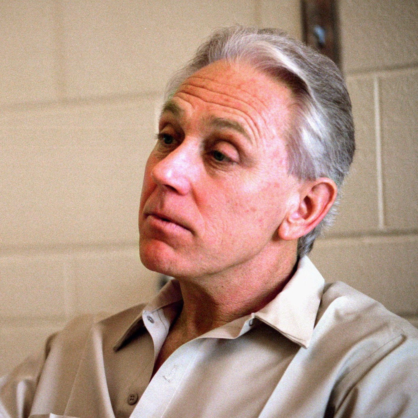 Army doctor Jeffrey McDonald, shown here in a 1995 photo, was convicted of murdering his pregnant wife and two daughters in the 1970s. He maintains that they were killed by a band of hippies.