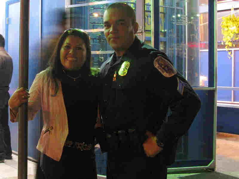 Prince George's County, Md., Police Officer Juan Damian and Dora Escobar outside one of her popular check cashing businesses.