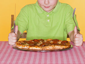 Adults tend to overestimate how much small children can eat, a child development researcher says.