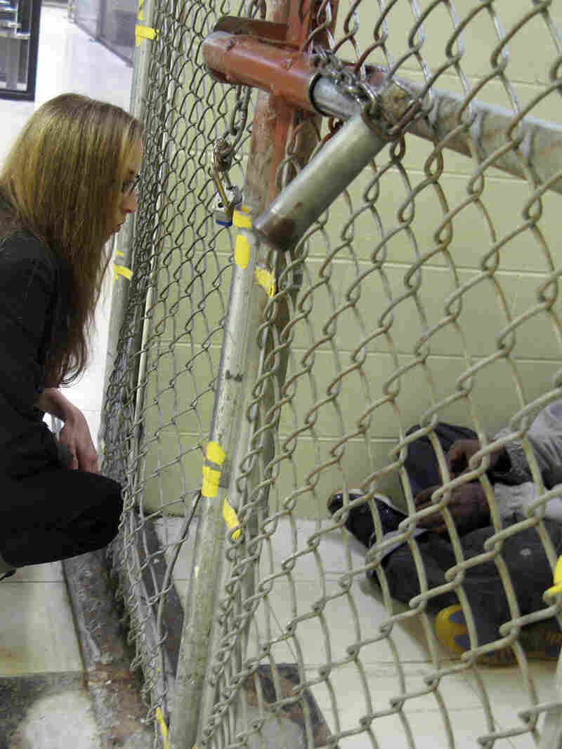 Elli Petacque Montgomery with the Cook County Sheriff's Office assesses a new inmate for mental illness.