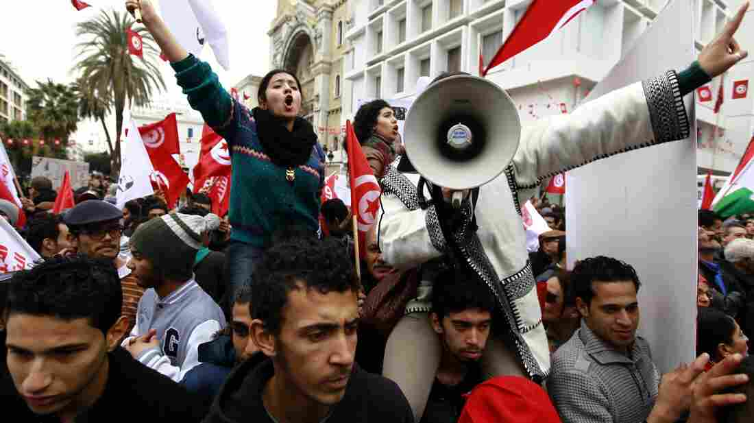 Supporters of Tunisia's secular Popular Front on Tuesday celebrate the third anniversary of the ouster of dictator Zine el-Abidine Ben Ali. The country is on the verge of approving a new constitution that was negotiated by Islamist and secular political parties.