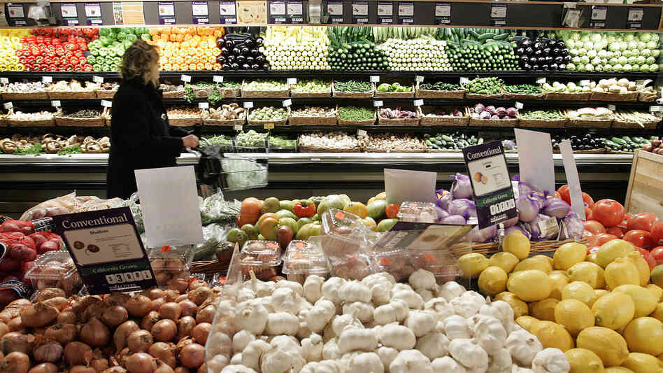 A woman shops in the produce section at Whole Foods in New York City. The company recently announced it would prohibit produce farmed using biosolids in its stores.