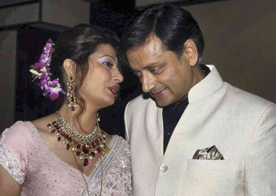 Shashi Tharoor listens to his wife Sunanda Pushkar at their wedding reception in New Delhi, India in 2010.
