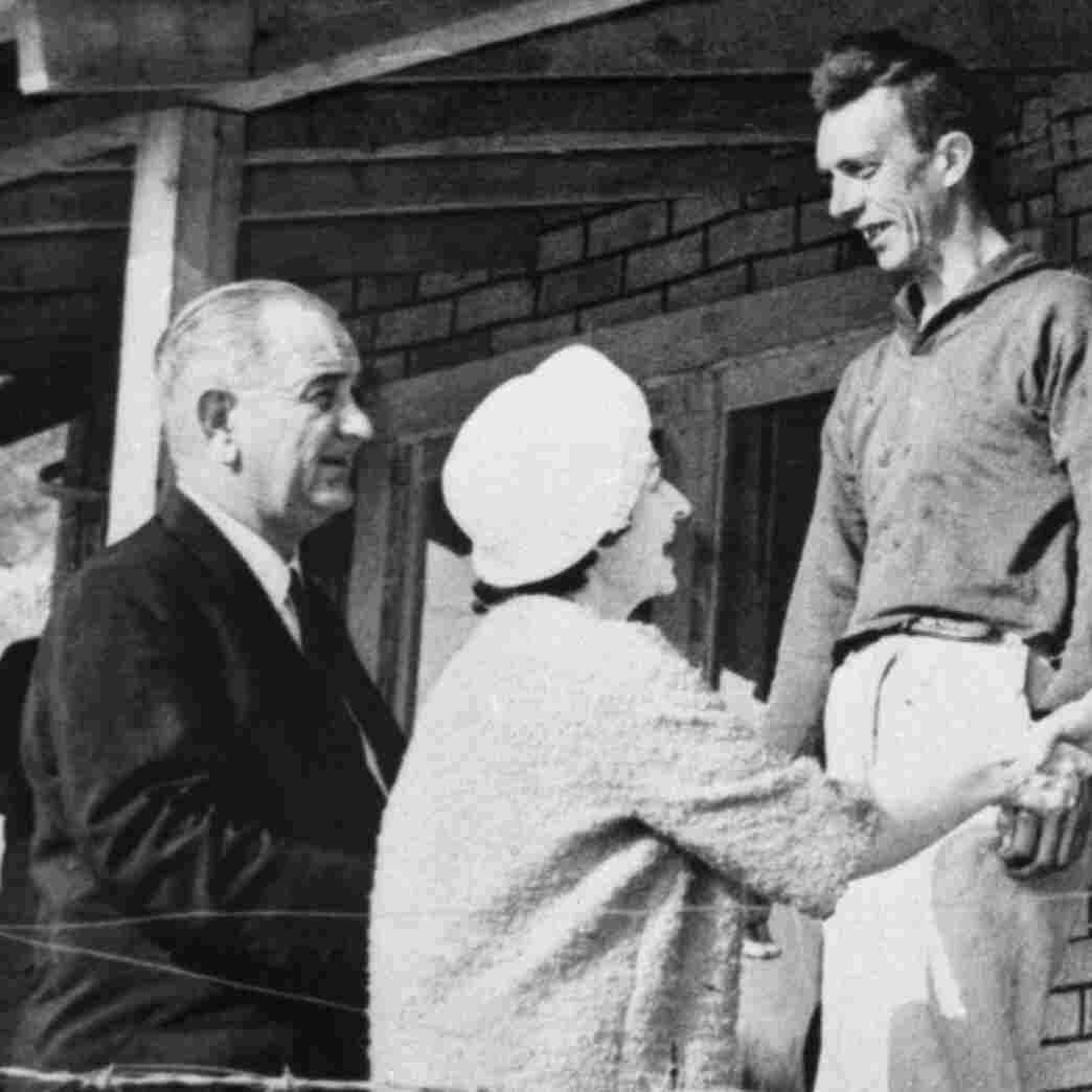 President Lyndon B. Johnson and his wife, Lady Bird, greet Tom Fletcher's family in Inez, Ky., in 1964. Fletcher was an unemployed saw mill worker with eight children.