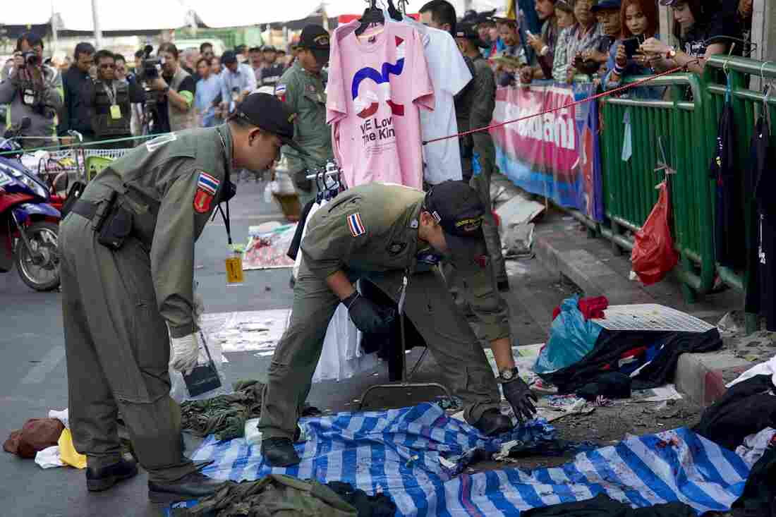 Police examine the scene of an explosion at a anti-government protest site on Sunday in Bangkok, Thailand.