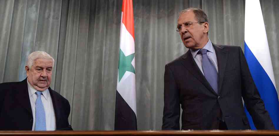 Syrian Foreign Minister Walid Muallem (left) and Russian Foreign Minister Sergei Lavrov attend a press conference in Moscow on Friday.