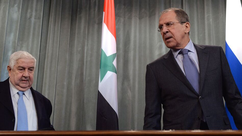 Syrian Foreign Minister Walid Muallem (left) and Russian Foreign Minister Sergei Lavrov attend a press conference in Moscow on Friday. (AFP/Getty Images)