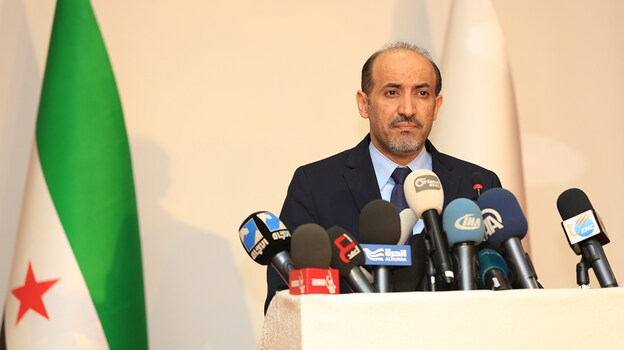 In Istanbul on Saturday, Syrian National Coalition President Ahmad Jarba announces the opposition group will attend the upcoming peace conference in Geneva. (AFP/Getty Images)
