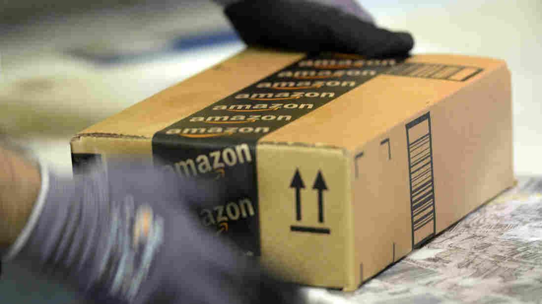 An employee prepares an order at Amazon's fulfillment center in San Bernardino, Calif.
