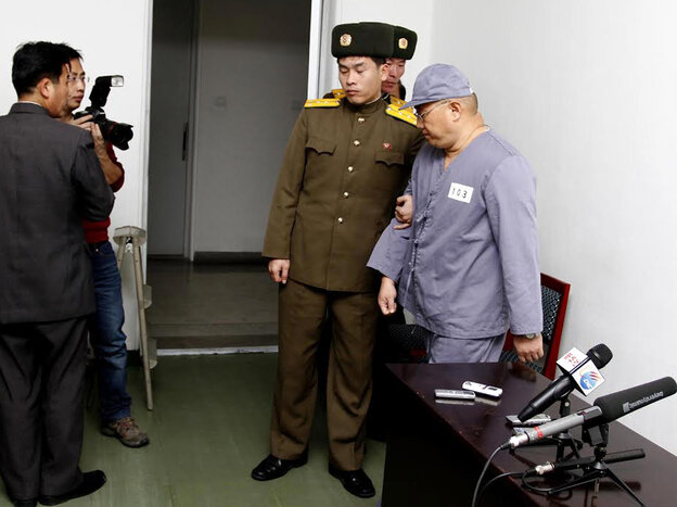 American missionary Kenneth Bae leaves after speaking to reporters at Pyongyang Friendship Hospital on Monday.