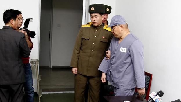 American missionary Kenneth Bae leaves after speaking to reporters at Pyongyang Friendship Hospital on Monday. (AP)