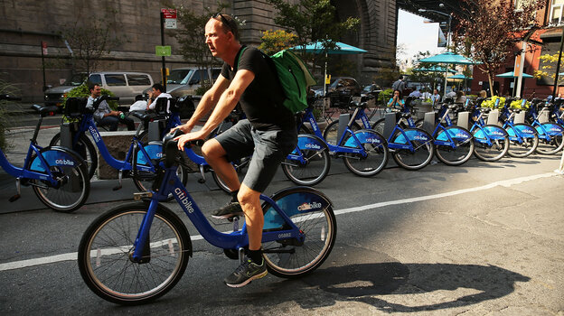 A major supplier to bike-sharing companies declared for bankruptcy this week — but experts say they still see the services spreading. Here, a man rides a Citibike through the Dumbo district of Brooklyn.