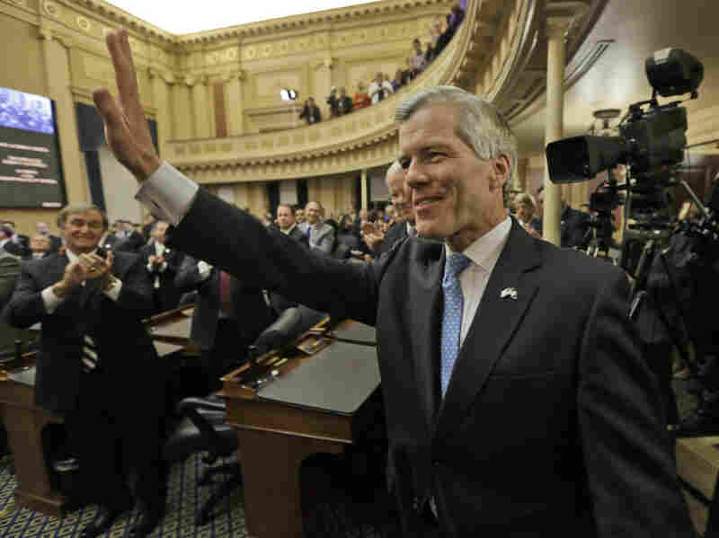 Virginia Gov. Bob McDonnell waves to the crowd after delivering his final State of the Commonwealth address before a joint session