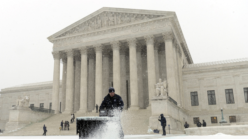 A worker clears snow from in front of the U.S. Supreme Court in Washington, D.C., on Tuesday. (AP)