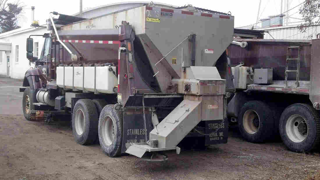 A salt truck is outfitted with side tanks that spray liquid cheese brine on the roads of Polk County, Wisconsin. Highway officials say the approach is more effective than using salt alone and reduces waste.