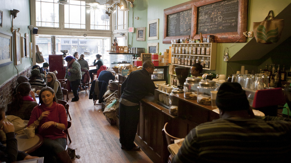The bustling Sidamo coffee shop in Washington's H Street Northeast neighborhood. The area has attracted many new, young residents and high-end bars, retail and restaurants over the past several years. (NPR)