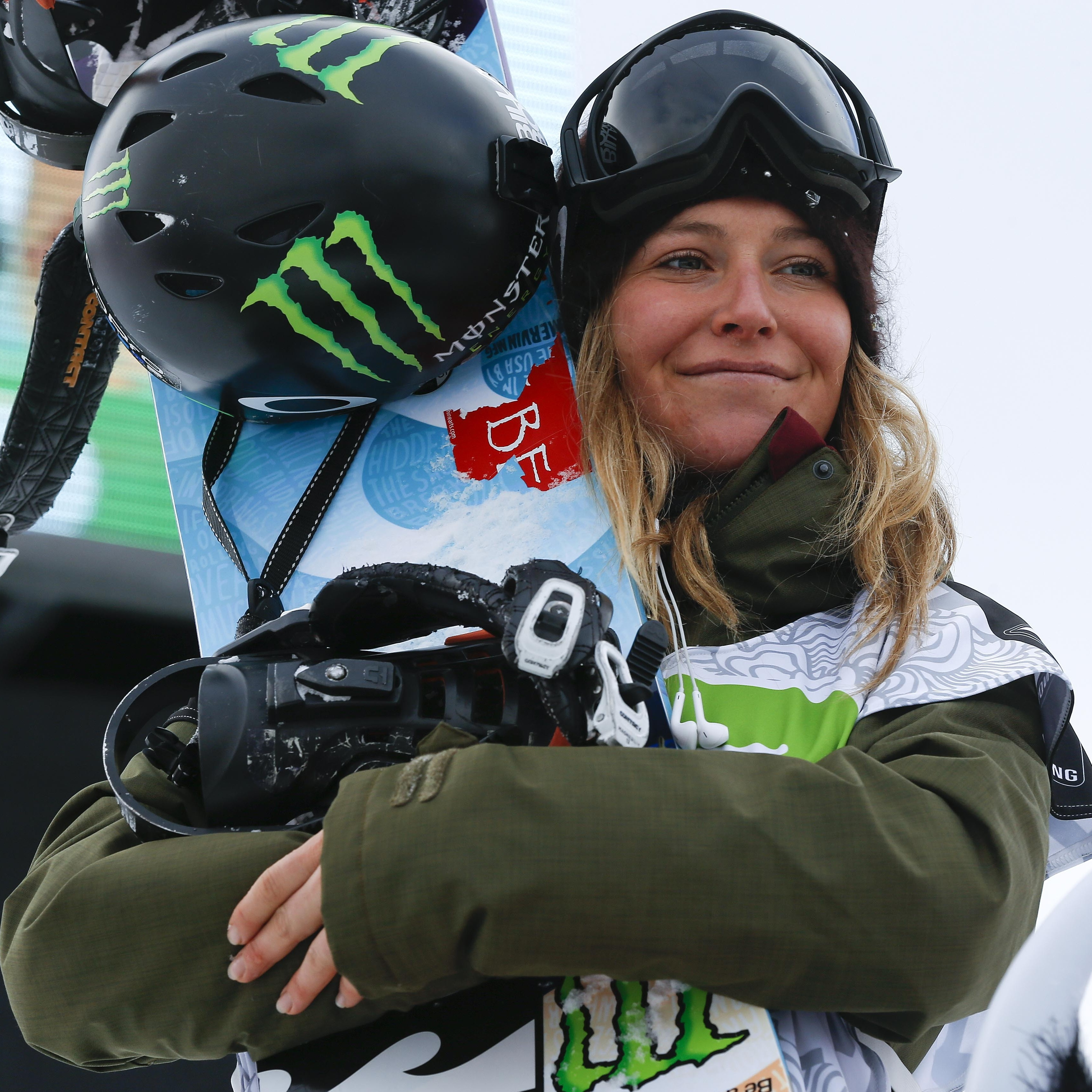Anderson stands on the podium after winning the women's slopestyle snowboarding final at the Dew Tour iON Mountain Championships last month.