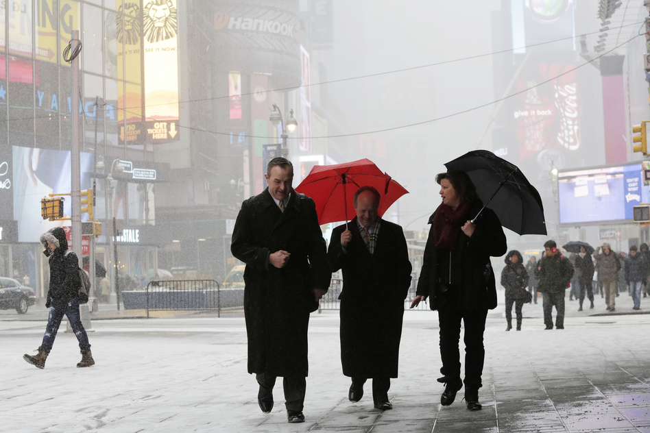 Pedestrians make their way through the snow in New York's Times Square.  (AP)