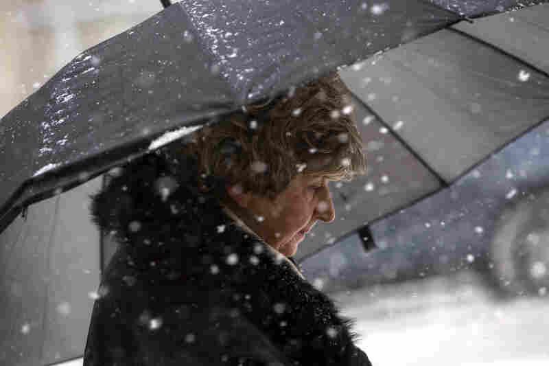 A woman walks through the snow in Hoboken, N.J.