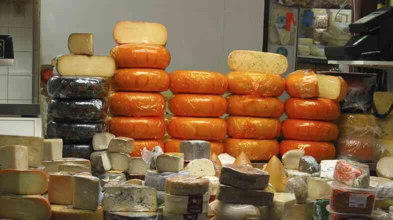 In Wisconsin, a dairy that makes mozzarella and provolone cheeses is giving its leftover salt brine to counties that use it to help melt road ice. Here, wheels of cheese are stacked in a deli.