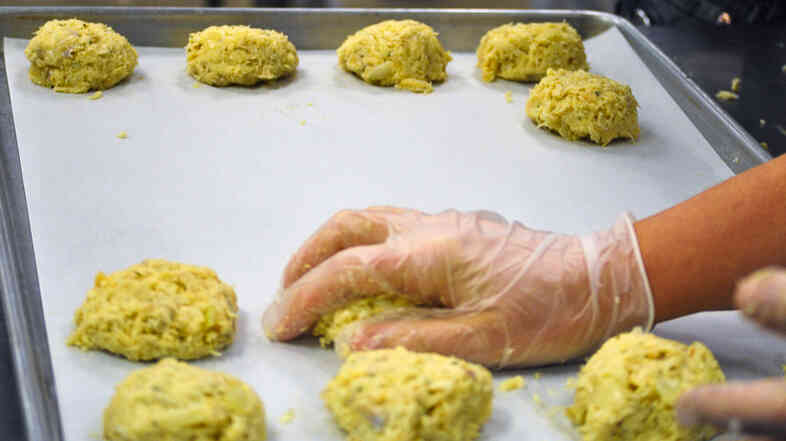 Students prepare fish cakes that will be part of a free dinner offered at Parkside Neighborhood Center in Portland, Maine.